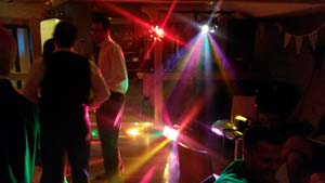 Disco sound activated effects lighting at a wedding party